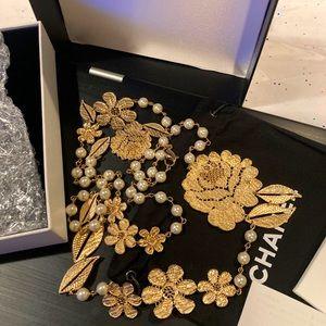 Chanel  Filigree Gold Tone Camellia Pearl Necklace